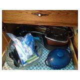 contents of top drawer - bundt cake pan, blue cast