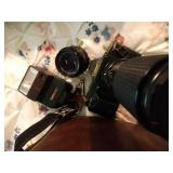 Canon T70 camera with lenses, flash and bag