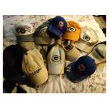 13 ball caps including Brewers, Packers and NASCAR