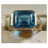 10k yg Ring with blue Topaz, 5.7 grams, size 7