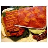 lot of placemats, table runners, and table clothes