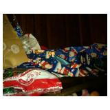contents of top shelf - Christmas wrap, bows,