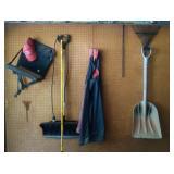 NW corner of garage - shovels, rake, hunting seat,