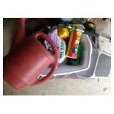 gardening lot - bag of mulch, watering can, plant