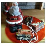 3 lited trains, standing Santa (heavy) and red