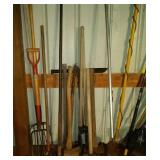 lot of hand tools - 3 axes, post hole digger, 4