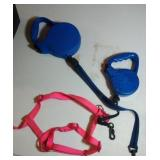 pair of retractable leashes and harness