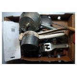 flat of kitchen utensils including potato mashers