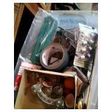 dish tub of hardware, door handles, tape, zip ties