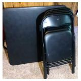 card table and 4 folding chairs - black in color
