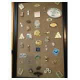 bulletin board of 40+ pins, some Packers