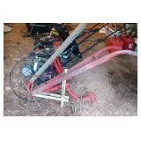 pair of 5 tooth high wheel cultivator