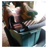 green tote of rugs