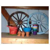 2 wagon wheels and 12 terra cotta pots