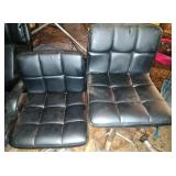 2 black pedestal chairs - adjustable height,