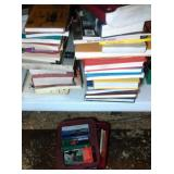 lot of books - 2 larger stacks and 1 small tote