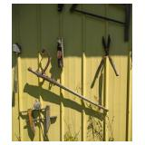 antique tools on side of pole shed -  8 pieces