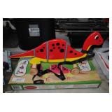 new wooden pull behind toy - dinosaur