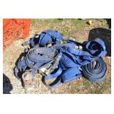 LOT OF LARGE HOSES AND SUBMERSIBLE PUMPS