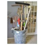 LARGE TRASH CAN WITH ASSORTED GARDEN TOOLS