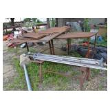 METAL TABLE WITH ASSORTED PIECES OF STEEL PLATES