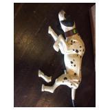 Wooden dog figure has broken leg