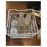 Milk bottles and wire crate