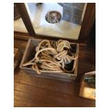 Canadian apple crate and bundle of rope