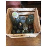 Ball mason jars and glass insulators in wood