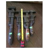 4 assorted antique pipe wrenches