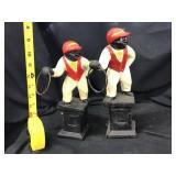 Two cast iron lawn jockeys