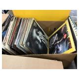 Box of records including Carly Simon, platters,