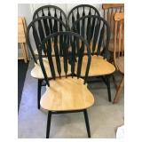 Five dark green wooden kitchen chairs, some wear
