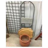 Step ladder, wooden toilet seat, flowerpot