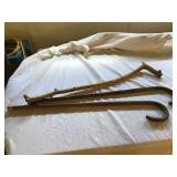 Three wooden canes