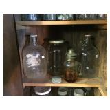 Glass jars, one made into oil lamp