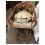 Wicker swivel chair and leaded glass swag lamp
