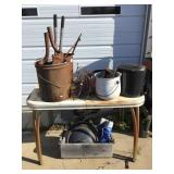 Table and contents of enamel pots, granite ware,