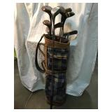 Golf bag and clubs, rusted and in rough condition