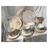 Cups and saucers, trinket box, plates, vase