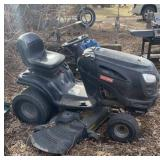 Riding a lawn Mower.