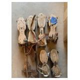 Box of antique roller skates.