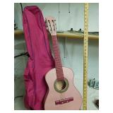 Pink kids acoustic guitar with bag