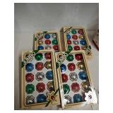 Four boxes of vintage glass ornaments