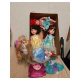 Three Disney princess dolls with horse and