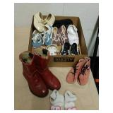Group of baby clothes includes cowgirl boots size