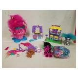 Group of troll dolls and accessories