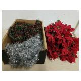 Group of poinsettias with tinsel Garland