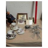Decorative bows teacups and saucers, picture