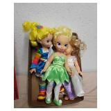 Two Disney princess dolls and Rainbow Brite doll